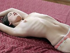 Sweet skinny beauty likes masturbating her shaved twat in crazy solo