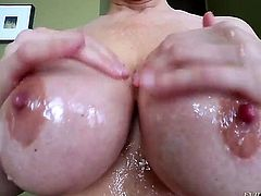 It is like Julia Ann has no gag reflex at all and her massive round breasts are always in the center of attention especially when they are oiled and bouncing.