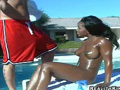 One of a kind long haired black goddess Lori with big jaw dropping hooters and delicious firm ass gets covered with oil and teases filthy dude outdoor by the pool