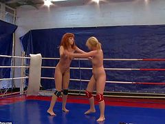 Attractive redhead bombshell Mai Bailey with big fake hooters and pierced nipple in tight booty shorts has amazing chick fight with furious blonde babe with delicious ass in the ring