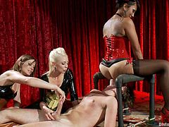 The main show this evening consists of one unfortunate schmuck getting tied up on stage and fucked and humiliated by two crazy dominatrix sluts.