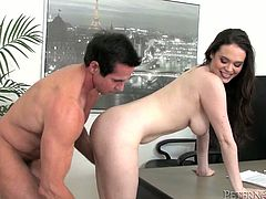 Thrifty brunette office manager gives a deepthroat blowjob to her overaged boss before she bends over a table for a poke in doggy style.