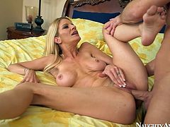 Seductive blond mom with stunning body shape is lying naked on a bed. She is penetrated in a missionary position and hammered deep in her cunt.
