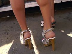 Short haired blonde babe with high heels is showing her butt on the spy cam