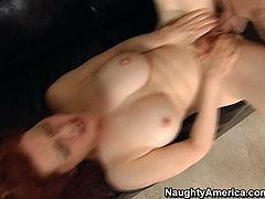 Lascivious hoe with feisty red hair color and big natural tits tops hard prick jumping on it fast. Her boobs are bouncing intensely while she rides.