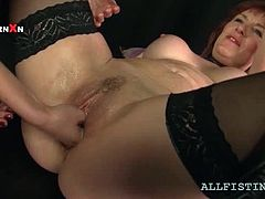 Mature lesbo bitch taking her GFs fist deep inside her large cunt