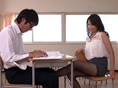 Amazing Japanese teacher seduces her student. She takes his dick out of the pants and gives nice handjob.