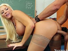 She is seductive blonde bitch with big fake boobs. She plays a role of a naughty teacher in Naughty America porn vid. She gets rammed bad doggy style. Awesome vid.