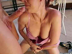Sexy and hot mommy wearing sexy red dress squats down to give tremendous deepthroat blowjob. The guy grabs her hair thrusting his dick deeper in her throat.