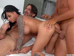 Christy Mack is a dangerously hot tattooed brunette with perfect big fake tits. She loves anal sex but gets double penetrated for the first time. She gets her asshole filled with one throbbing dick before she takes it in her vagina too.