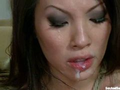 Slutty Asian girl undresses and sucks big dicks. After that she gets tied up and fucked in both holes at the same time.
