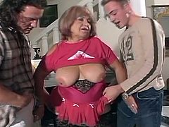 Watch the vicious mature slut wearing black stockings while sucking and riding two young cocks.