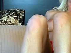 Effortlessly seductive blondie with nice tits and nice round ass slips off her sexy red lingerie and unleashes her elegant body for you. Then she masturbates her pussy with her naughty fingers.