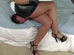 Arousing brunette bitch Kelly Divine with juicy hooters and big ass in leather skirt and high heels dominates over her boy toy and enjoys sitting on his face in bedroom