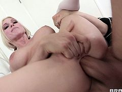 Arousing blonde with big tits likes huge cock pounding her mouth and tight little pussy