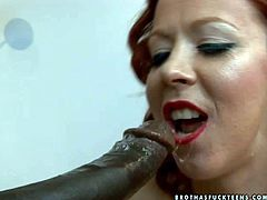 Take a look at seductive and curious redhead chick Trinity Post sucking big ebony cock. This dirty foxy slut will show you all her sucking skills
