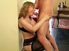 So handsome dude Danny Wylde gets seduced to have sex by beautiful blonde mature woman Nina Hartley. She stays in stockings and sucks dick first of all. Watch continuation.