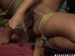 Mandy Bright and Oliva are going crazy in a basement. Oliva ties Mandy up, strokes her body and then drills her vag with a dildo.