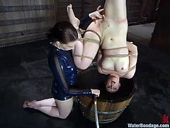 Caroline Pierce and Claire Adams make great performance in BDSM video. One chick gets tied up and hosed by another girl.