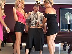 Blonde, hot and with a lot of sexual experience these cougars don't miss the opportunity of sucking a young guy like Pauly. They surround him and begin sucking his dick right there near those stairways. After having a taste of his cock they go in the living room where things get more intense.