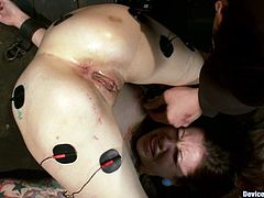 Tattooed girl gets tied up in unimaginable pose. After that the guys toys her pussy and conducts electricity through her body.