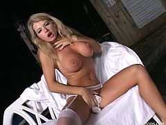 She's blonde and fucking hot, those big breasts, sexy legs and naughty ass can make any guy kneel in front of her but Vicky rather prefers to play alone. She rubs her cunt and takes off those white stockings before going in the water where she rubs her pussy. Her sexy body looks great wet!