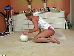 Kathia Nobili shows the way she keeps fit in this homemade video featuring alluring blond-haired porn girl doing exercises on the floor. Watch blondie in skin tight shorts do it.