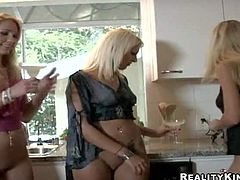 Attractive arousing long haired young blonde lezzies Nikki, Sammie Rhodes, Angelica Saint and Eva with smoking hot bodies in short sexy skirts get filmed while having fun in the kitchen