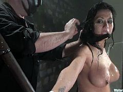 Asian girl with nice boobs gets undressed and tied up. After that he turns powerful jet of water on her and drowns in an aquarium.