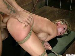 Superb blonde chick gets tied up and fucked rough in her tight ass. After that the guy fixes clothespins to her hot tits.