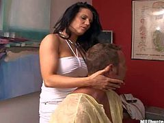 Arousing skillful black haired milf with big juicy hooters in tight short white dress massages dirty naked dude and takes on his stiff meaty sausage in awesome fantasy filmed in close up
