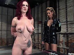 Get a load of this redhead's amazing body, especially her big natural tits in this bondage clip where she's tortured and pleased.