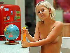Teen bitch Monroe got in her hands big yellow dildo toy and naughtily posing with it and demonstrating precious young and juicy boobies!