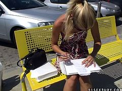 Pretty blonde Sophie Moone shows how she spends her usual day. She drives to some shop and then has rest on a bench.