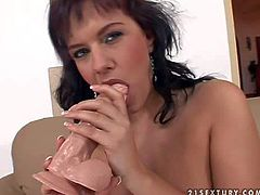 Turned on dark haired slut with nice ass and sexy french manicure fingers shaved meaty fish lips on leather couch and starts playing with rubber dildo while her lover films her in close up