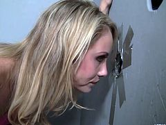 Charlie Monroe is a sexy blonde on the toilet. She notices a gloryhole and after enticing the man on the other side he puts his dick through. She deep throats the massive dick while on the other side of the restroom wall.