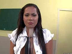 Dark haired schoolgirl Cipriana pulls down her panties and gets her bare butt spanked from your point of view in the classroom. Watch bad girl in black and white uniform get punihsed.