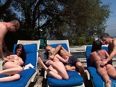 Three tasty looking Russian whore take sunbath by the pool while laying on the deckchairs by the pool. Later two aroused fuckers join them to receive a zealous deepthroat blowjob in steamy group sex clip by Fame Digital.