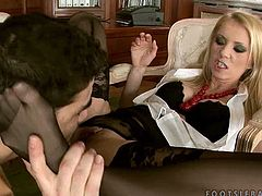Sexy blonde chick Alexa Weix wearing cute black stockings is having fun with her man in a study. She lets him lcik her feet and pussy and then tehy have hot doggy style sex.