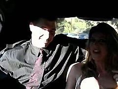 Chris Johnson and Kayla Paige sit on the back seat of the luxurious car. Pretty soon she will show her magnificent boobies and he is going to try out her lovely cunt.