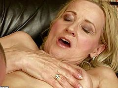 Filthy long haired blonde granny with hanging hooters in high heels only gets her cunt licked good and pounded to orgasm by turned on very y oung buck on leather couch