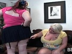 Two BBW lesbian teens in sexy outfits seducing each other on the couch