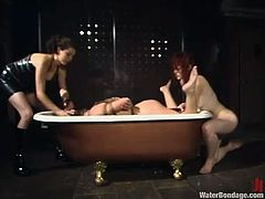 Justine Joli and Sarah Blake get gagged with spider gags and then tied up. Later on they get drowned by their mistress.