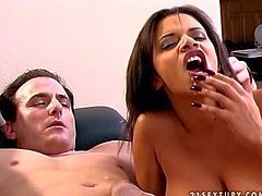 Arousing and busty ebony hottie enjoys in pleasing her white lover on the bed with a nice blowjob session and makes him cum all over her really good in the end