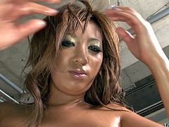 Busty Japanese babe Hina Maeda oiled up for a threesome