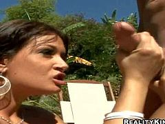 Short haired bootylicious brunette bombshell with big firm hooters and amazing oral skills gets down on knees and gives sucks horny Ramon Nomar with long meaty cannon in backyard on a sunny day