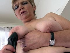 This short haired grandmother puts on a show for all the fans out there of older, mature women. She rubs the tip of the dildo on her nipples just for you to pound off to. She fingers herself and sucks on it, too.