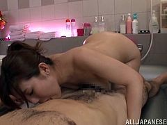 Horny Japanese girl takes her clothes off and soaps her body in the bathroom. After that she gets her vagina licked and fucked.