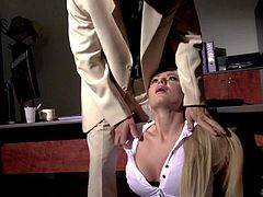 Elegant leggy blonde secretary in sexy black stockings gets caught smoking by her boss. She lifts up her short skirt and spanks her sexy buttocks like crazy. And thats just the start of the action.