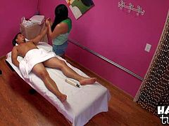 Long haired stacked asian lady gives pleasure to naked guy on mssage table. Clothed exotic woman with tender hands touches his body all over before she takes his cock. She gives cock massage with desire.